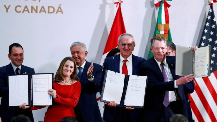 Canadian Deputy Prime Minister Chrystia Freeland, Mexican Deputy Foreign Minister for North America Jesus Seade, U.S. Trade Representative Robert Lighthizer pose next to Mexico's President Andres Manuel Lopez Obrador and Mexico's Finance Minister Arturo Herrera during a meeting at the Presidential Palace, in Mexico City, Mexico
