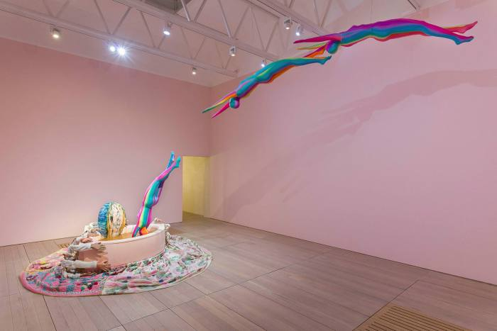 Multicolored human figures fly across the room in a vat