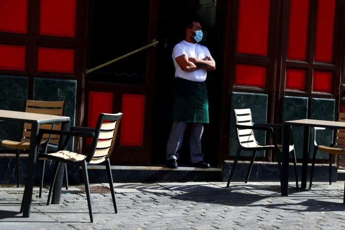 A waiter waits for customers amid the coronavirus outbreak in Madrid, Spain.