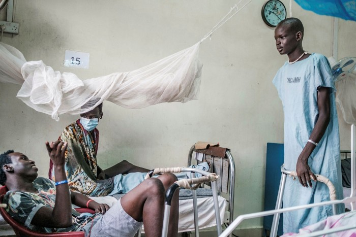 Patients who suffered gunshot wounds on a ward in a military hospital in Juba. Violence erupted in South Sudan two years after its 2011 independence, leaving 400,000 people dead and derailing the nascent state-building process