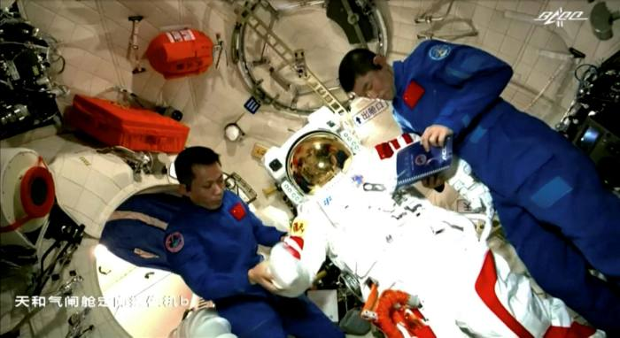 Astronauts Tang Hongbo and Liu Boming at work on China's space station  - https 3A 2F 2Fd1e00ek4ebabms - Alleged assault on scientists overshadows China's space race success