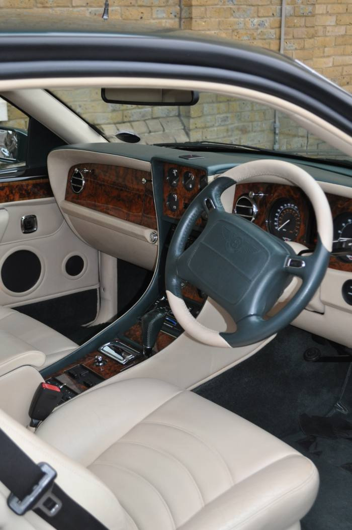 TheContinental R's pristine ivory-leather interior