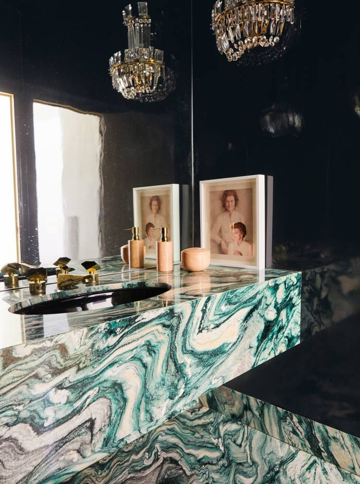 The guest powder room in Rancho Mirage features a1980s Vanity Fair portrait ofBetty Ford