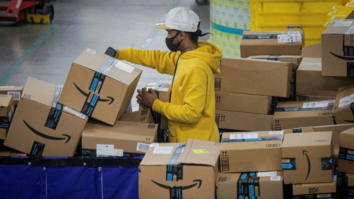 Amazon employee scans packages