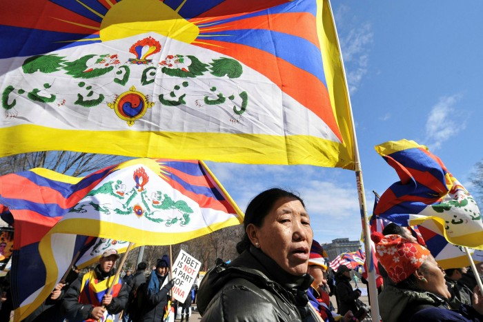 Pro-Tibet protesters carry flags in London during Xi Jinping's visit to Washington in 2012