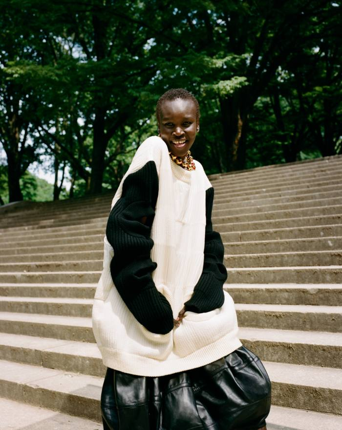 Louis Vuitton wool jumper, £2,900, and leather skirt, £3,900. Jil Sander by Lucie and Luke Meier gold Globe necklace, £1,290. Model, Alek Wek at Storm London. Hair, Hos Hounkpatin at The WallGroup. Make-up, Christine Cherbonnier at The Wall Group. Photographer's assistants, DougSegars and Bryan Anton. Stylist's assistants, Paget Millardand Shant Alvandyan. Production, De La Revolución