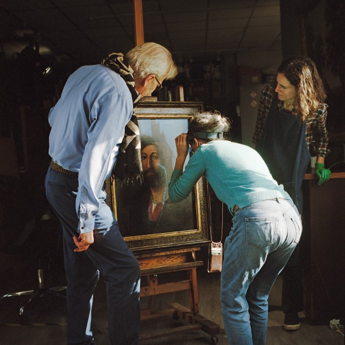 Gillespie at work with two of his senior accredited conservator-restorers (from left), Majo Prieto Pedregal and Maria Giulia Caccia Dominioni