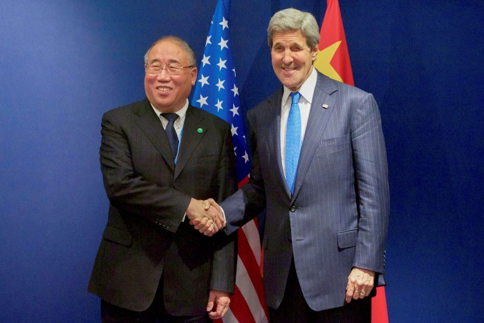 Xie Zhenhua and John Kerry meet in 2015 on the margins of the Paris climate change summit