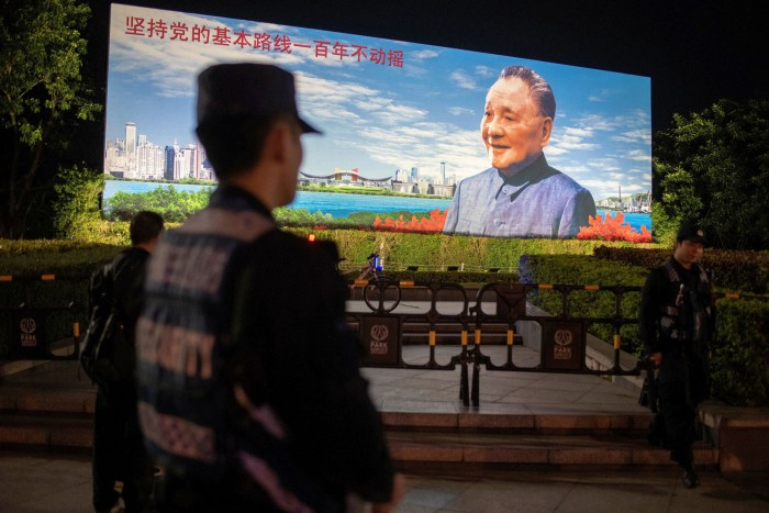 Shenzhen: a billboard features Deng Xiaoping, the late Communist party leader who opened up the Chinese economy in the 1970s. Wu Xiaohui is married to Deng's granddaughter