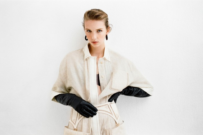 Fendi embroidered linen jumpsuit, £2,690, and embroidered canvas and leatherbelt, £980. Mukadi jersey bra, £72. MM6 Maison Margiela leather gloves, £385. Hannah Martin ebonyand gold Warrior earrings, £3,420