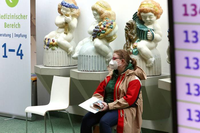 A woman waits for her Covid-19 vaccination at a centre in Hagen, Germany