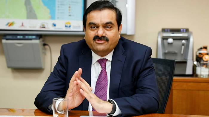 Shares linked to Indian tycoon Gautam Adani tumble on foreign funds freeze  | Financial Times
