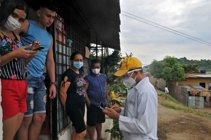 Medical staff interview residents of Guayaquil, Ecuador, during the Covid-19 pandemic. Zambia, Ecuador and Rwanda have all announced in recent weeks that they are struggling to repay their debts