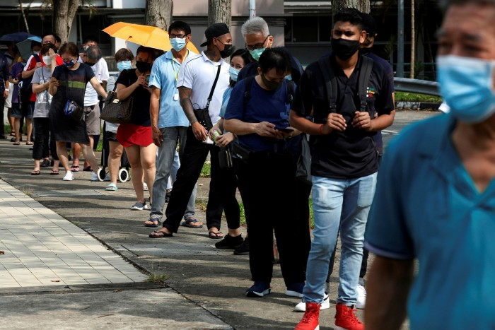 In Singapore, people lined up for quick testing of the Covid-1 ant antigen