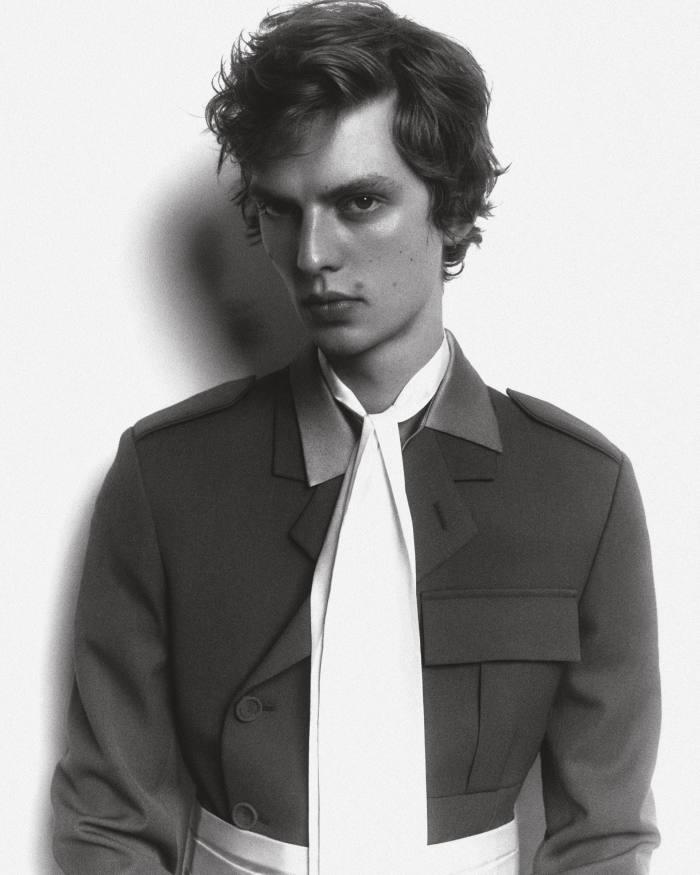 Leon wears Dior woolcavalry twill military jacket, £3,000. Ludovic de Saint Sernin silkshirt (seen at collar), £475. Charvet cotton piqué tuxedo belt, £260. Silk scarf, stylist's own