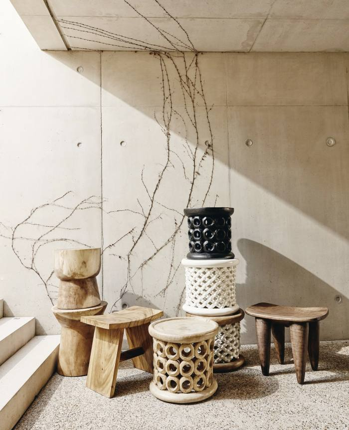 Khayni Bamileke and Donut stools (front and stacked), from £620, and Senufo stool (far right), £640