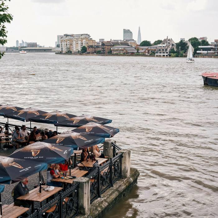 The pub's terrace juts into the Thames
