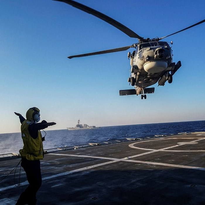 A helicopter lands on the deck of a ship during a Greek-US military exercise in the eastern Mediterranean near Crete on Monday