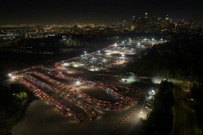 People wait in cars at a Covid-19 mass vaccination site at Dodger Stadium in Los Angeles, California. The US is on the cusp of delivering 100m doses