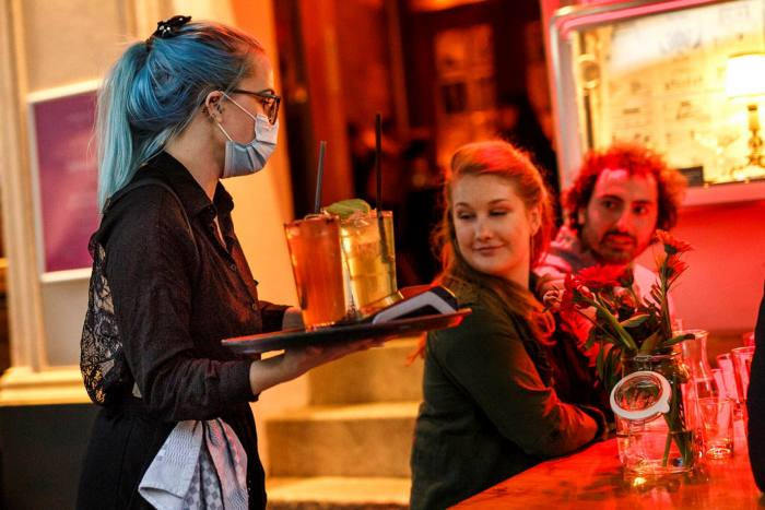 A cocktail bar in Berlin last week. Surveys show that just one in three Germans plan to go for a night out in the next month