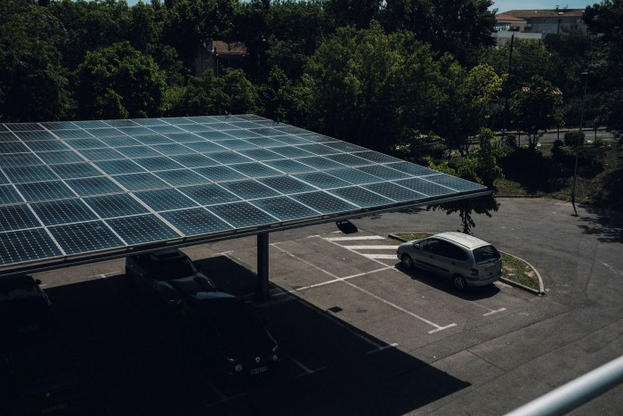A supermarket car park in Marseille with a solar-panelled canopy. The costs of the EU's decarbonisation drive can only be mitigated if all revenues are recycled back to compensate vulnerable households and fund investment in cleaner technologies, says a study by Cambridge Econometrics