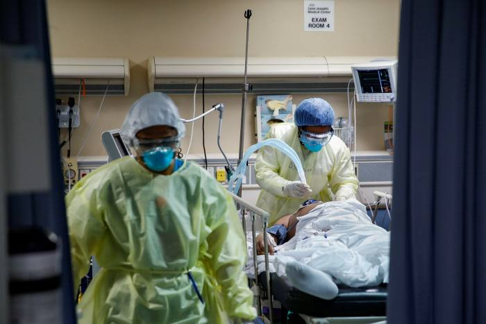 A Covid-19 patient on a ventilator at St Joseph's Hospital in Yonkers, New York, in April. Respiratory symptoms are the first signs doctors look for