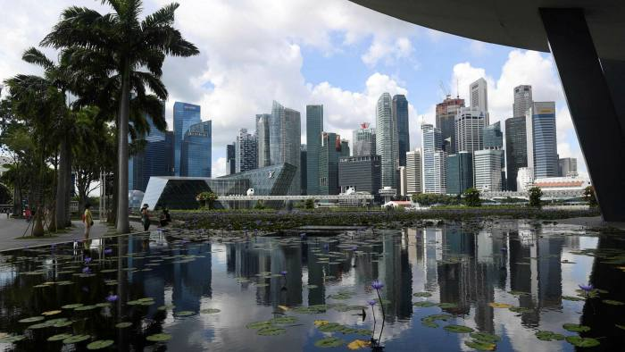 Singapore's skyline. A low-key effort appears to be under way to add more jobs in Singapore and reduce staffing in Hong Kong without angering Beijing