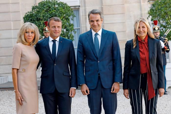 Grabowski-Mitsotakis (right) and her husband, the Greek prime minister Kyriakos Mitsotakis, meet Emmanuel and Brigitte Macron