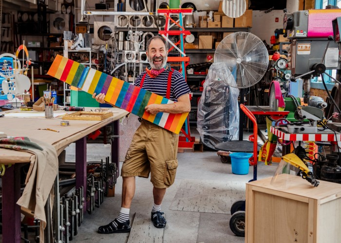 Shire in his LA studio, wearing his signature stripes.