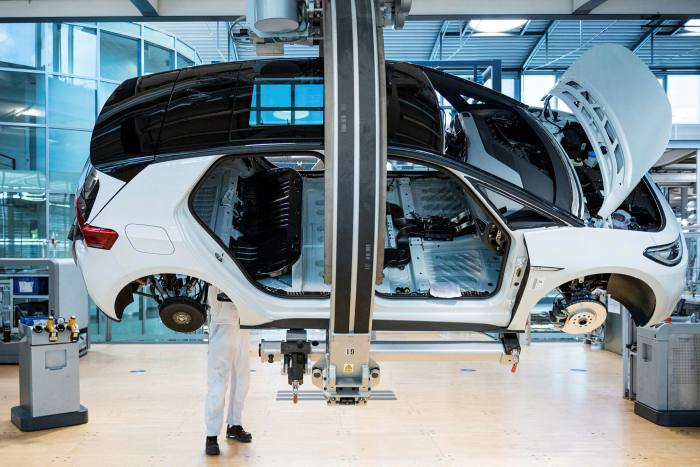 The assembly line for the Volkswagen (VW) ID 3 electric car of German carmaker Volkswagen, at the 'Glassy Manufactory' (Glaeserne Manufaktur) production site in Dresden, eastern Germany