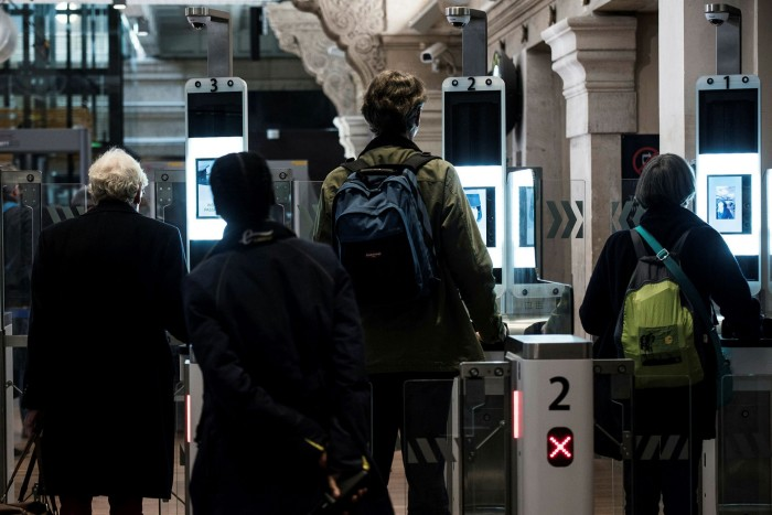 Passengers use their biometric passport at an ePassport gate equipped with a facial recognition system at the British border of the Eurostar at the Gare du Nord in Paris in 2017