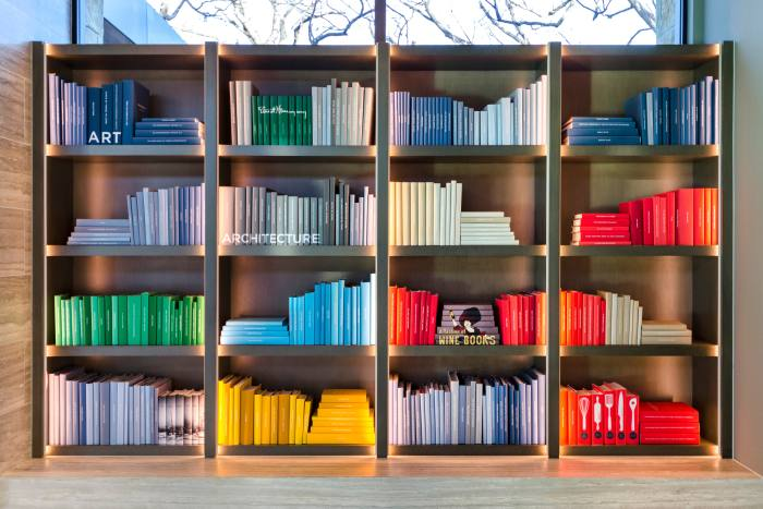 A colourful library curated for a client by Juniper Books