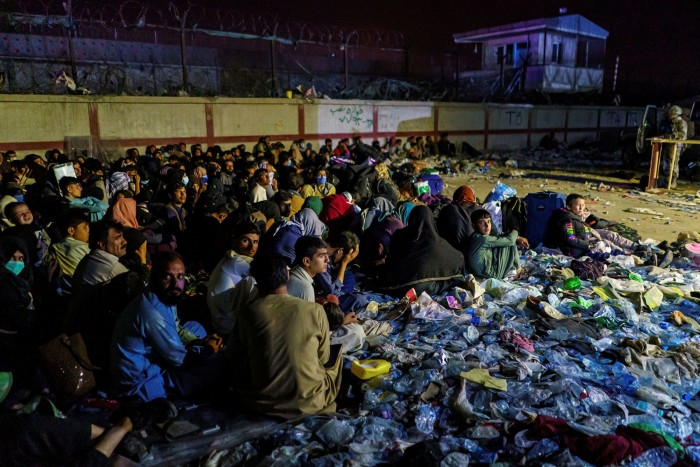 Afghan civilians gather outside Kabul airport. Some people have been taking as long as 48 hours to cross the capital though multiple Taliban checkpoints, according to UK officials
