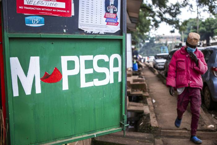 A sign for the M-Pesa mobile payment system in Nairobi, Kenya, that allowed millions of people without bank accounts to make cash withdrawals and deposits, transfers and payments through their mobile phones