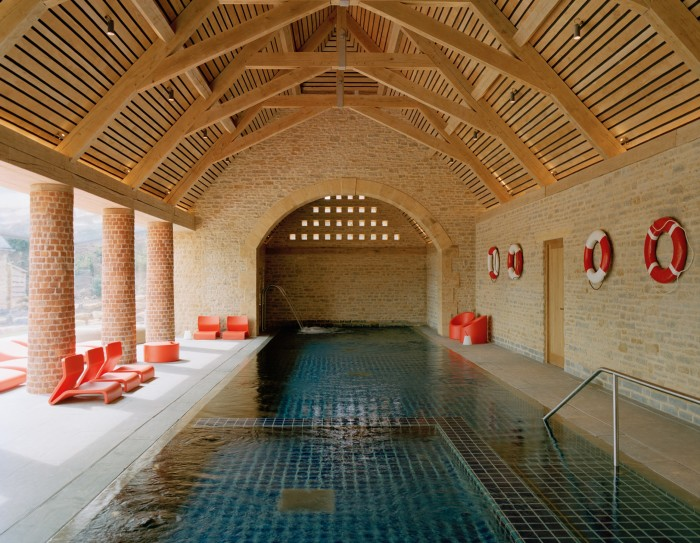 The pool is housed in a former barn, with roof beams crafted by local artisans