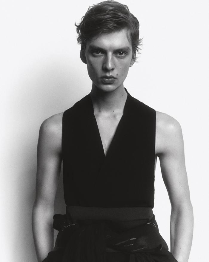 Leon wears EmporioArmani cotton and viscose top, £240. Maison Margiela linen coatwith wet-look detailing (seenaround waist), £2,245. JWAnderson cotton trousers, £445. Ralph Lauren silk cummerbund, £230
