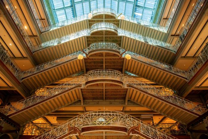 Wrought iron balconies and railings on the grand staircase in the main atrium of La Samaritaine