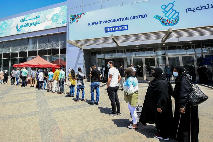 Residents queue at a vaccination centre in Kuwait City