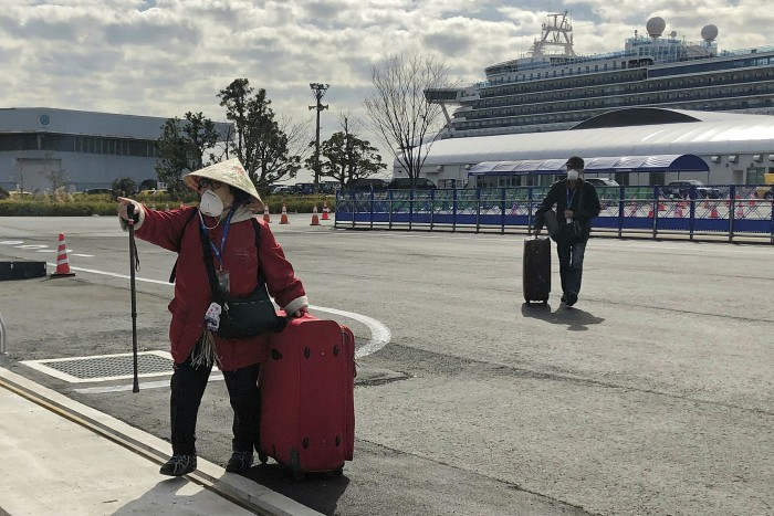 Passengers leave Diamond Princess cruise liner