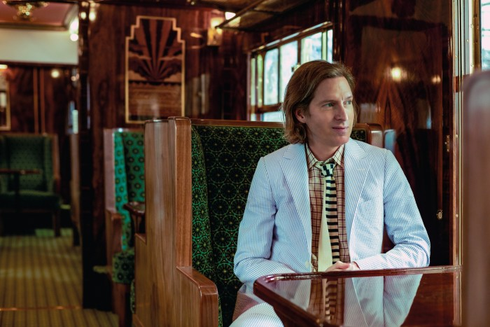 Wes Anderson in the Belmond British Pullman coach he designed