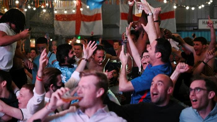 Fans in London celebrate during the semi-final match between England and Denmark. © Leon Neal/Getty