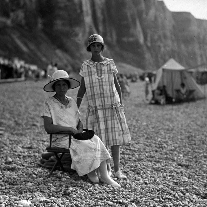 Étretat has long been a favourite of fashionable French society, from this Parisian mother and daughter seen here in 1920 . . .