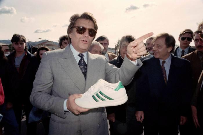 Bernard Tapie holding an Adidas shoe