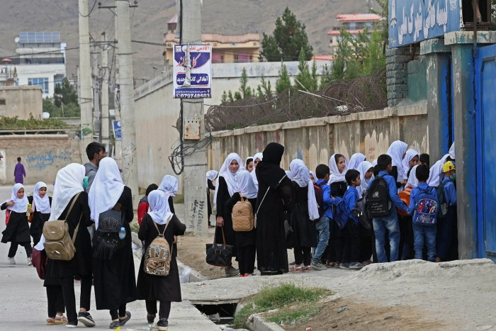 Children arrive at a primary school in Kabul on Monday after the Taliban reopened classrooms for younger students