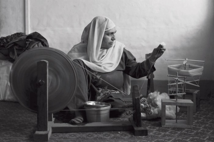 The spinning, done by women by hand on a charkha wheel, is an ancient skill under threat