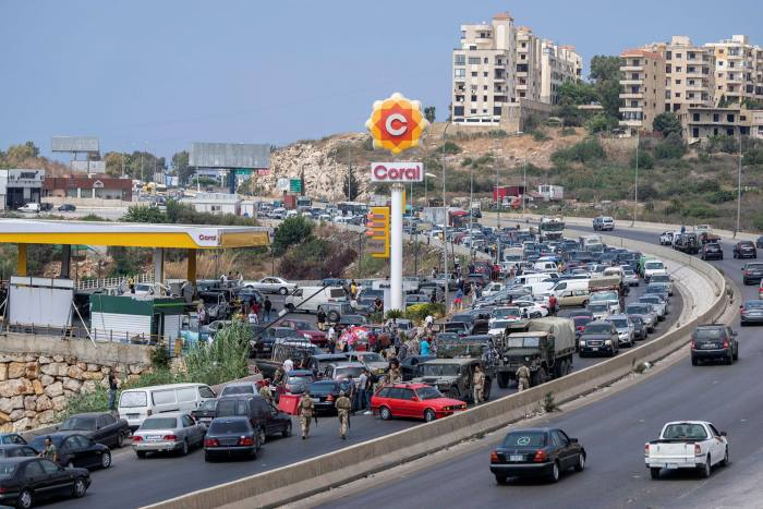 Motorists try to fill their cars up in Jiyeh