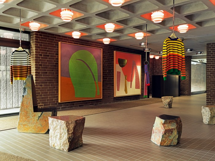 Knitwear from the Stripes collaboration with artist Jacob Dahlgren hangs in the lobby, interspersed with granite seats by Max Lamb