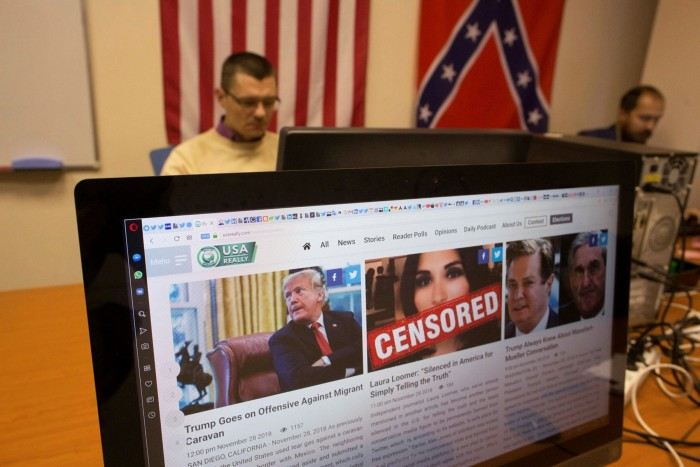 A page featuring editorial from the USAReally.com website sits on a desktop computer monitor. A man and a Confederacy flag are in the background