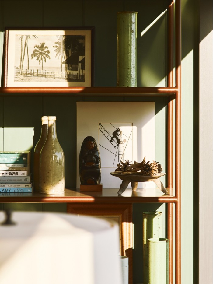 The study belonging to Orlebar Brown founder Adam Brown and his husband Tom Konig, with shelving by Studio Reed