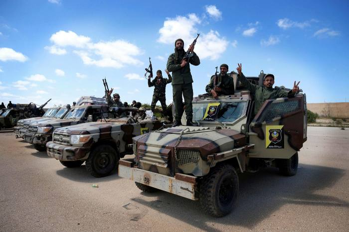 Libyan National Army members head out of Benghazi to reinforce the troops advancing to Tripoli, in April last year